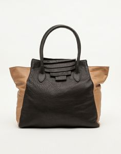 Super soft and slouchy oversized leather tote bag from Collina Strada, featuring signature leather pleat details.