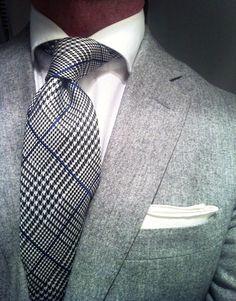 Light charcoal jacket, patterned tie, crisp white shirt and pocket square