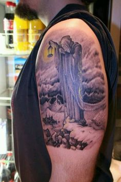 A really dark and meaningful Grim Reaper tattoo design. You can see that the Grim Reaper is seemingly waking along a certain path while looking down on a town with a lamp.