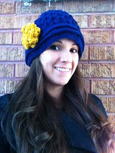 Materials: *Red Heart Yarn in Navy and Gold (This hat took about 1/2 skein of navy and just enough Gold to make the flower as big as you...