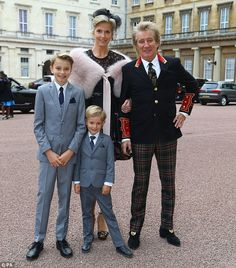 Proud moment: Rod Stewart was joined by model wife Penny Lancaster and their two children, Alistair and Aiden, on Tuesday afternoon as he received a knighthood in recognition of his services to music and charity