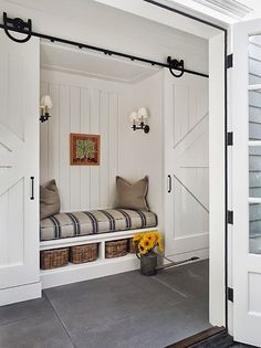 Possibility for our laundry / mud room.  Hang barn door in front of washer & dryer.  Then build hooks and cubbies (and bench?) onto the barn door. This is in addition to building cabinets & folding shelf around the wash & dryer.