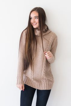 • Taupe turtleneck sweater with detailed knit work • Available in sizes S/M, M/L. Model is wearing a size S/M • 55% COTTON, 45% ACRYLIC