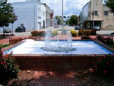 A cool look at Harrington Square from the (soap-filled) square fountain! Rockingham NC, Richmond County