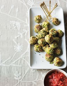 Ground almonds and eggs hold these veggie-laced alternatives to traditional meatballs together. For appetizer-size meatballs, shape into 30 smaller rounds instead of 12, and bake 15 to 20 minutes. Broccoli Meatballs with Garlic-Tomato Sauce, 4.0 out of 4 based on 5 ratings