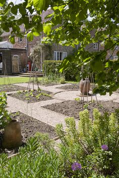Once a plain lawn, the garden has been developed into smaller areas dedicated to growing veg and flowers #WTgardens