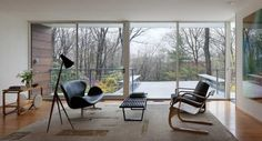 midcenturia:  Alvar Aalto chairs and cart, Arne Jacobsen sette, Luxus lamp, Nelson bench. via