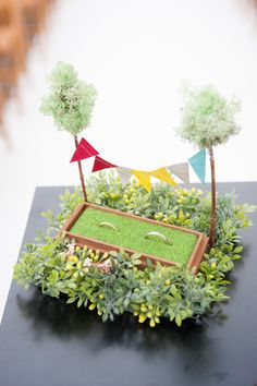 A cute miniature garden for the ring tray is a perfect idea and a quite different one. Moreover, the additional details like tiny trees and paper bunting going across from one tree to other make it look quite realistic. Sunflower Wedding Decorations, Engagement Decorations, Diy Wedding Decorations, Handmade Decorations, Wedding Gift Baskets, Wedding Gift Wrapping, Wedding Gift Boxes, Engagement Gift Baskets, Ring Holder Wedding