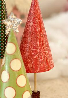 Paper Christmas trees...cute and simple. I love the glitter covered spools.  But then I love glitter covered anything.