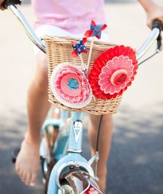 Child's bicycle basket with bright 4th of July decorations. A fun way to decorate for your Patriotic parade!