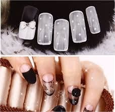 White, see-through nail art.