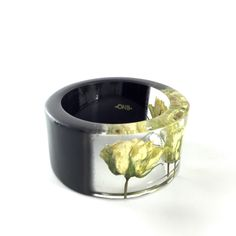 A personal favorite from my Etsy shop https://www.etsy.com/listing/233477428/three-real-roses-bangle-bracelet