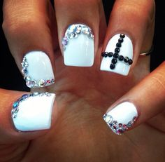 One of my favorite set of nails I've had #cross #bedazzle #white #nails