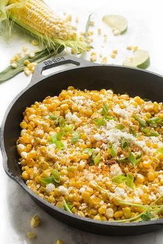 Skillet Mexican Street Corn - a fast side dish recipe Fresh sweet corn is sautéed with spices before being tossed with lime juice and topped with cilantro, onions and Mexican cheese. Taco Side Dishes, Mexican Dishes, Side Dish Recipes, Food Dishes, Mexican Food Recipes, Dinner Recipes, Mexican Cheese, Mexican Corn, Barbeque Side Dishes
