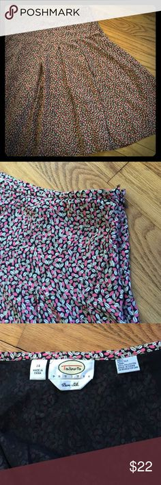 "Beautiful Talbots silk skirt, 14P Size 14 Petite 100% silk skirt from Talbots. Beautiful pink, tan, and cream design on a black background. Lining is 100% polyester. Waist: 32"". Length: 25"". Lined. Side zip. Hook missing from hook & eye closure. Dry clean only. All items from a clean, smoke-free home. Please feel free to ask any questions or make an offer! Talbots Skirts A-Line or Full"