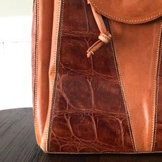 #ShareIG Vintage, artisan leather tote curated and ready for sale in my shop. Made from alligator leather in beautiful, rich orange tones. #alligator #leather #boho #hobo #tote #fashion #geometry #geometric #vintage #vintagefashion #forsale #alligatorpurse