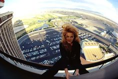 Entertainer Ann-Margret sits on the railing of a hotel balcony in Las Vegas. Swedish Actresses, Ann Margret, Las Vegas Hotels, Hanging Out, Airplane View, Hollywood, Culture, Pop, American