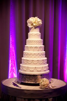 Elegant and simple seven-tier wedding cake.  Photo by Studio 563.  #wedding #cakes