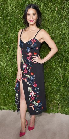 Look of the Day - Olivia Munn struck a pose at the CFDA Fashion Fund Awards in a Tanya Taylor LBD with a thigh-high slit and floral Swarovski crystal embroidery, with Eva Fehren jewelery and fuchsia Chloe Gosselin pumps.