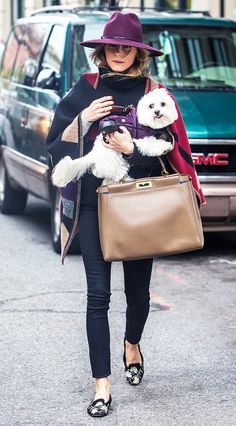 Olivia Palermo takes a stroll with her pup in NYC wearing a maroon fedora, Burberry blanket scarf, and floral flats