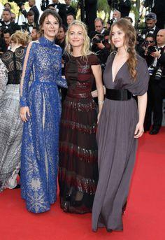 """Cannes - jour 5 : la montée des marches de """"The Homesman"""" -  Joséphine Jappy, Mélanie Laurent avec des boucles d'oreilles et bracelet Chaumet et Lou De Laage."""