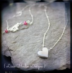 Sterling silver heart with ruby www.lissa73.etsy.com