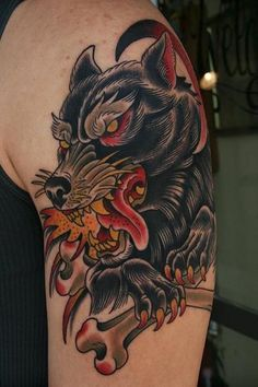 wolf-traditional-tattoo-on-biceps.jpg 400×600 pixels