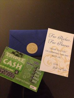 For Richer, For Poorer Wedding Favors - blue envelope from Paper Presentations stuffed with a note and scratch off lottery ticket. Sealed with a gold sticker!