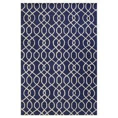 """Featuring an intricate trellis motif and hand-tufted craftsmanship, this chic wool rug lends a stylish touch to your living room or den. Pair it with patterned furniture to create an eclectic feel, or let its cosmopolitan design stand on its own.    Product: RugConstruction Material: WoolColor: NavyFeatures:  Hand-tuftedLoop and cut pile  Pile Height: 0.5""""Note: Please be aware that actual colors may vary from those shown on your screen. Accent rugs may also not show the entire pattern ..."""