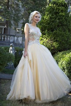 Jovani Prom - 93412 An amazing cap sleeve ball gown featuring intricate beading on the bodice in champagne at Estelle's Dressy Dresses!  #estellesdressydresses #prom2014 #champagne