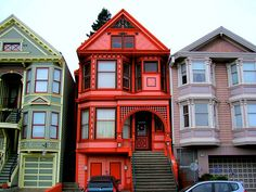 Whoever painted this house wanted to make sure that his visitors could find him.  A red Victorian house in San Francisco, California.