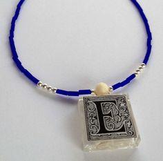 """Monogram """"E"""" Glass Tile Necklace #glasstilejewelry http://www.ecrafty.com/c-6-photo-jewelry.aspx"""