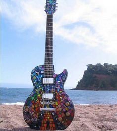 I want this amazing guitar. Looks like that's one of Muse's album covers on it.