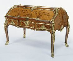 "1750 French Double desk at the J. Paul Getty Museum, Los Angeles - From the curators' comments: ""The double form of this unusually large desk is unique. When lowered, both sides form writing surfaces and reveal drawers and pigeonholes veneered with marquetry. The finely cast and chased gilt-bronze mounts delineate the edges of the drawers, front, and legs. On the fall fronts of the desk, bunches of marquetry flowers seem to sprout from the sculptural mounts."""