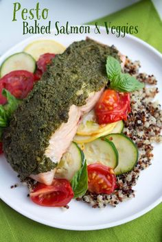 Pesto Baked Salmon with veggies. A quick, easy, and delicious dinner recipe!