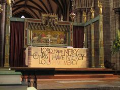 """high altar-        The photo being taken on Ash Wednesday, the hangings on the altar are those for the penitential season of Lent that was just beginning.  The words are a translation of the ancient Greek prayer """"Kyrie eleison"""" that has been used since the earliest days of Christianity."""