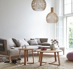 A welcoming living room with soft colours and birch Octo 4240 pendants by Secto Design. Photo: Peter Fehrentz, Germany.