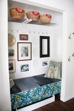 Convert an old heavy closet into a cubby with easy storage with a custom bench, baskets and hooks. Fantastic storage and organization, especially for families!