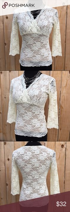 """Lace 3/4 Sleeve Top This Polyester Spandex blend lace top is lined. Lining is tan & lace top is an off white. Flat lay relaxed measurement is 16"""" pit to pit and 22"""" long. In excellent preloved condition with NO spots or holes. CAbi Tops"""