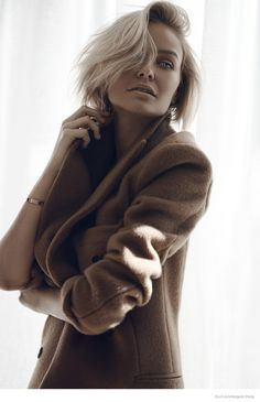 Lara Goes Neutral--Australian socialite and model Lara Bingle takes the spotlight for this online feature for Elle.com. Wearing neutral tones, Lara poses f