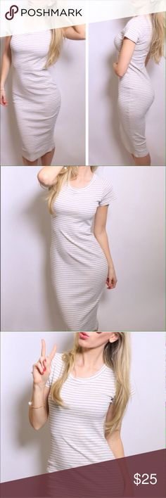 Oatmeal Midi Brand new, never worn oatmeal t shirt midi dress, oatmeal in color with thin black and grey stripes which gives it a classy look! Has great stretch, bought from @ 11thstreet but it's too big on me  that's why I'm reselling. Fits true to size and maybe bigger bc of the stretch. 80% cotton 20% rayon. Very comfortable. Great day dress. Dresses Midi