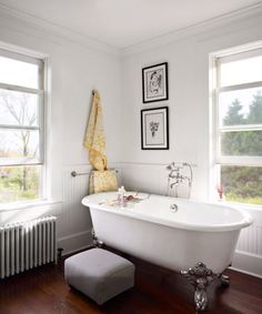 The couple converted a former studio apartment into a luxurious retreat, including this bathroom. The claw-foot tub, by Kallista, shares the space with a glass-walled shower.