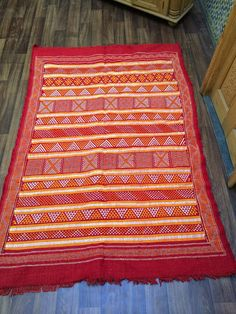 Nomad Tribal Embroidered Kilim This is a woolen rug made from simple weaving techniques. The patterns on the rug are traditional and tribal Saddle Blanket, Berber Rug, Weaving Techniques, Woven Rug, Rug Making, Floor Mats, Scandinavian Style, Kilim Rugs, Bohemian Rug