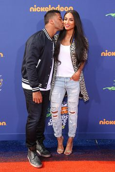 Take that, Future! After the rapper dissed his ex, Ciara, by calling her relationship with Russell Wilson a sham, she and the Seattle Seahawks quarterback decided to prove him wrong. The couple showed off their love with some PDA on the red carpet at the Kids' Choice Sports Awards!