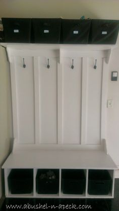 Could do the hooks area similar to this, but with cupboards on each side