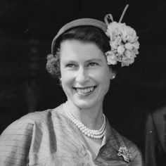 Queen Elizabeth II at Doncaster Racecourse to see the St Leger. An avid racing fan, she began riding lessons at the age of three and is renowned for her knowledge of thoroughbreds and breeding.
