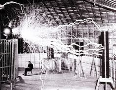 8 Things You Didn't Know About Nikola Tesla  }  Publicity photo of Nikola Tesla sitting in his laboratory in Colorado Springs in December 1899
