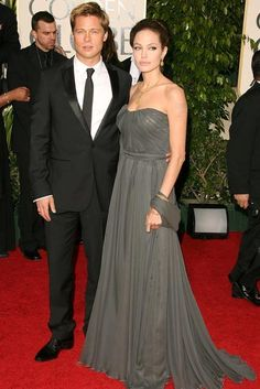 65 Best Golden Globe dresses of all time -   ANGELINA JOLIE -   You get two smoking hot styles for the price of one when it comes to Angelina Jolie and Brad Pitt. The pair opted for old-school Hollywood glamour and matching smouldering pouts at the 2007 Golden Globes - with Brad in a J.Lindeberg tux and Ange in a charcoal grey, strapless St John gown. (2007)