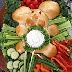 "Bunny Bread | ""I made this for Easter. It was easy and came out so cute! I gave him green onion whiskers and craisen eyes--the kids loved it. After using bunny as a dip with veggies, we used the remainder bread to go with dinner. Delicious!"""