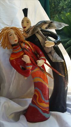 THE COUPLE. This one-of-a-kind (OOAK) figurine was made by hand using recycled materials. The top layer is made of Paper Mache clay. This sculpture is hand painted with acrylic paint and covered with special varnish.  This is a perfect gift for yourself, your family or someone special who likes sculptures. Suitable for home& office decor.  To see more of my works, please visit my site:  nyassour.wixsite.com/naomiart